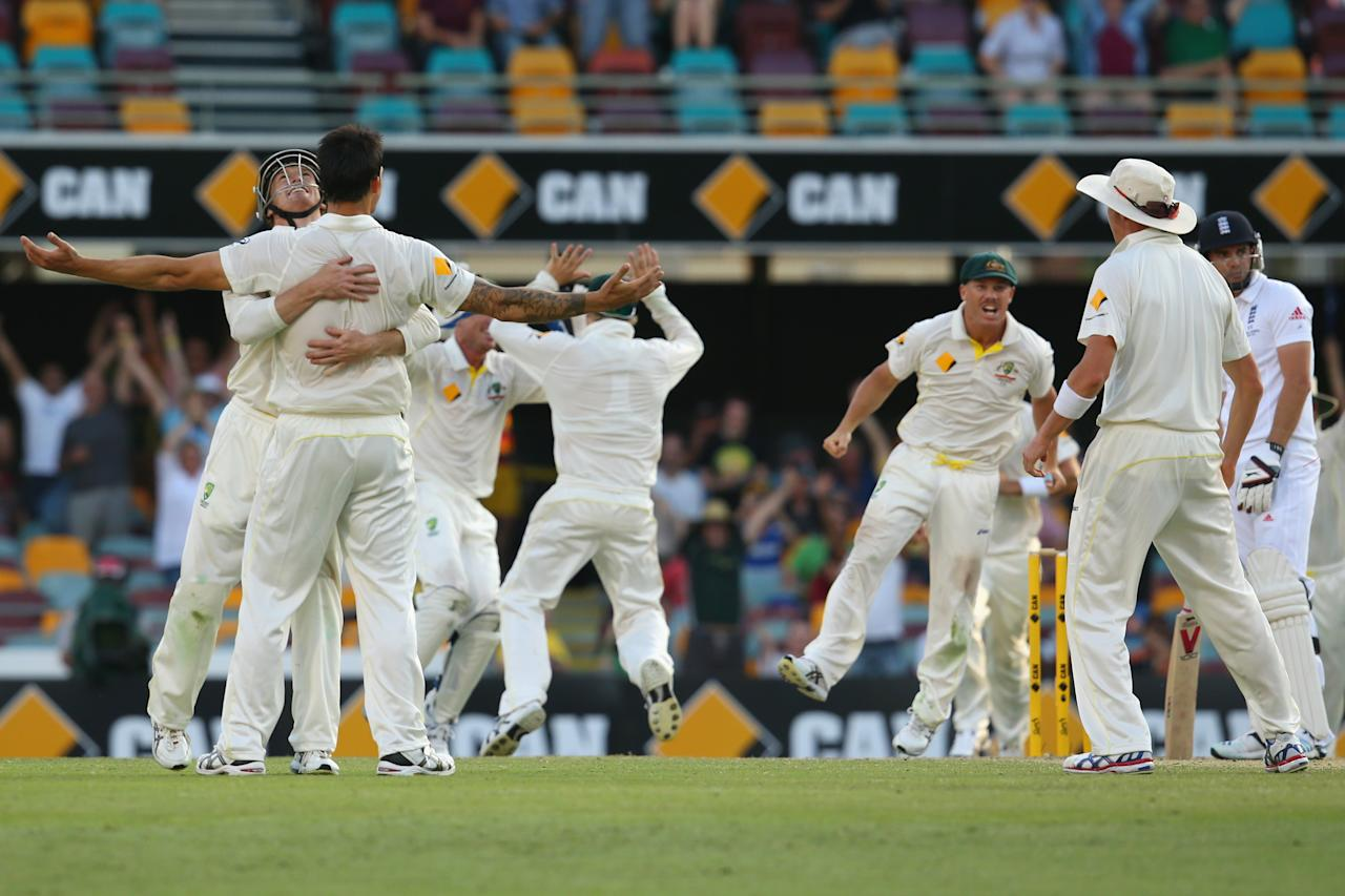 BRISBANE, AUSTRALIA - NOVEMBER 24:  Australia celebrate victory after Mitchell Johnson of Australia took the wicket of James Anderson of England during day four of the First Ashes Test match between Australia and England at The Gabba on November 24, 2013 in Brisbane, Australia.  (Photo by Mark Kolbe/Getty Images)