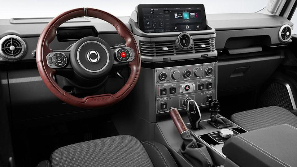 The interior's simple, no-nonsense layout includes over-sized knobs designed to be used while wearing gloves. - Credit: Photo: Courtesy of INEOS Automotive.