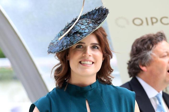 Princess Eugenie wearing turquoise dress and big hat