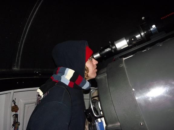 Space journalist Elizabeth Howell using the 14-inch telescope in the observatory at the Mars Desert Research Station.