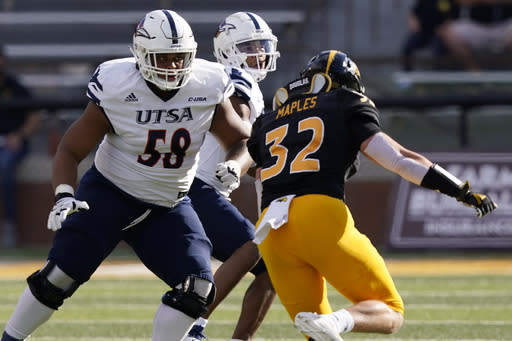UTSA offensive lineman Terrell Haynes (58) drops back to protect UTSA quarterback Frank Harris, in the background, from Southern Mississippi linebacker Hayes Maples (32) during the first half of an NCAA college football game, Saturday, Nov. 21, 2020, in Hattiesburg, Miss. UTSA won 23-20. (AP Photo/Rogelio V. Solis)