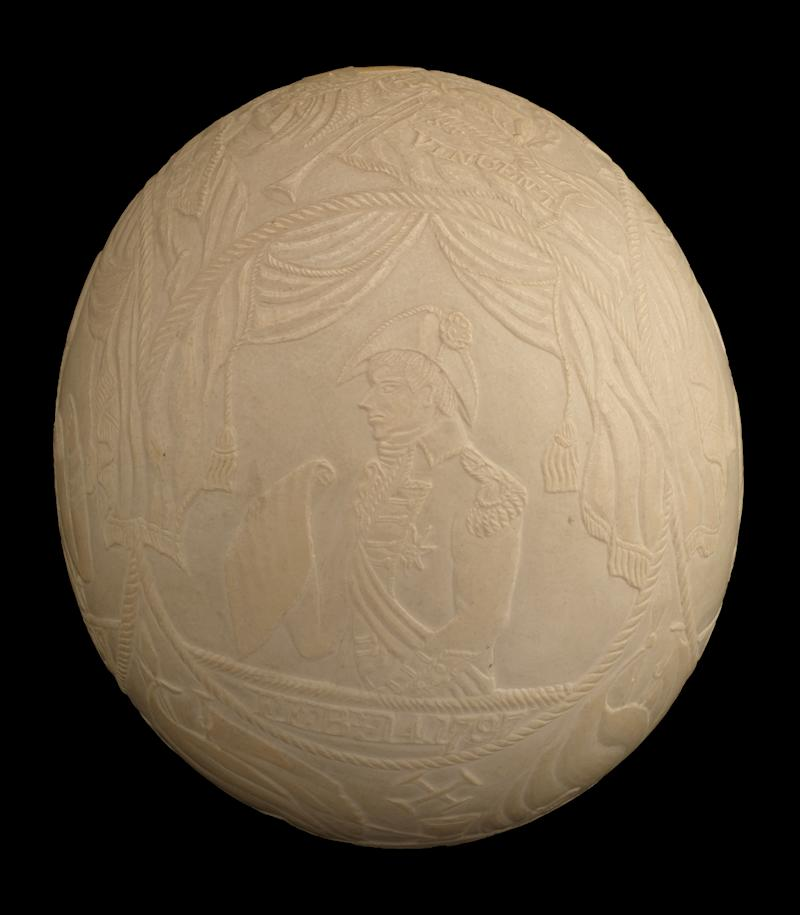 The finely carved Battle of Trafalgar ostrich egg depicting famous Royal Navy commanders is also being sold (Dominic Winter Auctioneers/PA).
