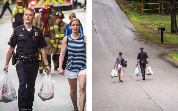 Police officer Tyler Coady helps carry groceries a half mile to a woman's home after her road had been closed. (Photo: Infonh via Facebook)