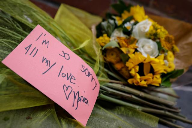 <p>A note and flowers are left near the site where a man driving a rented pickup truck mowed down pedestrians and cyclists on a bike path alongside the Hudson River in New York City, Nov. 1, 2017. (Photo: Brendan McDermid/Reuters) </p>