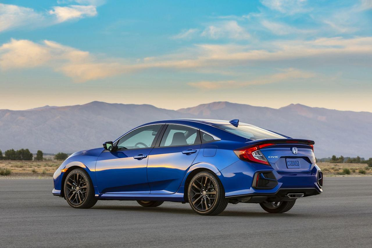<p>At the rear of the 2020 Civic Si sedan, we see a redesigned bumper with what looks like little body-colored whiskers. The new rear bumper design is only for the sedan; the coupe stays the same. The changes are small and you need a keen eye to spot them, but we think they're tasteful.</p>