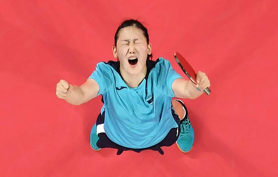 An overview image shows Spain's Maria Xiao celebrating her victory over Hong Kong's Minnie Soo Wai-yam during her women's singles round 2 table tennis match at the Tokyo Metropolitan Gymnasium during the Tokyo 2020 Olympic Games in Tokyo on July 25, 2021. (Photo by Jung Yeon-je / POOL / AFP) (Photo by JUNG YEON-JE/POOL/AFP via Getty Images)