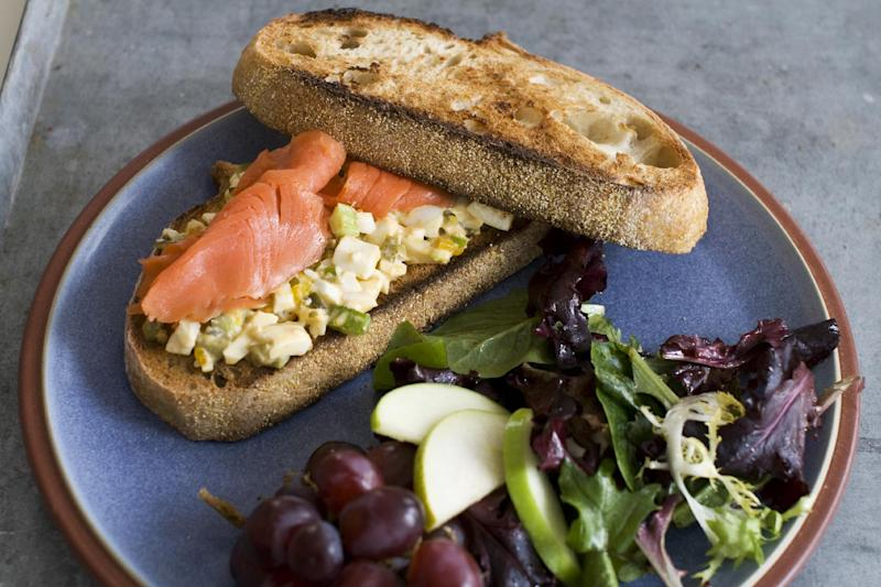 In this image taken on April 1, 2013, an egg salad sandwich with smoked salmon is shown served on a plate in Concord, N.H. (AP Photo/Matthew Mead)