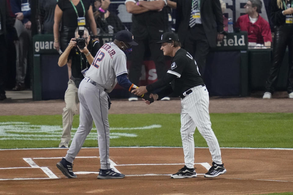 Houston Astros manager Dusty Baker Jr., left, and Chicago White Sox manager Tony La Russa greet each other before Game 3 of a baseball American League Division Series, Sunday, Oct. 10, 2021, in Chicago. (AP Photo/Charles Rex Arbogast)