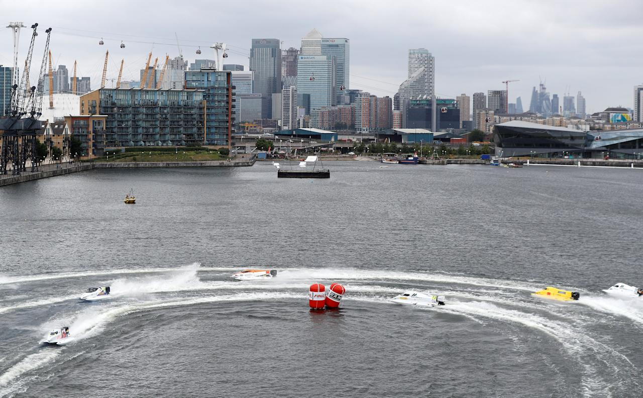 F1 powerboats race across the water, with the financial district of the city in the background, in the F1H20 London Grand Prix in the Royal Victoria Dock in London, Britain, June 17, 2018. REUTERS/Peter Nicholls