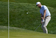 Chris Kirk chips to the green on the ninth hole during the second round of the The Players Championship golf tournament Friday, March 12, 2021, in Ponte Vedra Beach, Fla. (AP Photo/John Raoux)