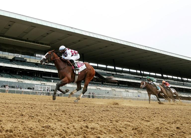 Tiz the Law, ridden by Manny Franco, powers to victory in the 152nd Belmont Stakes in front of an empty grandstand at Belmont Park in Elmont, New York