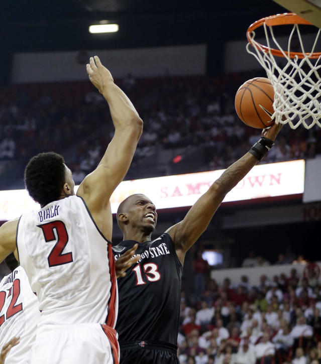 UNLV's Khem Birch, of Canada, left, covers a shot form San Diego State's Winston Shepard during the first half of an NCAA college basketball game on Wednesday, March 5, 2014, in Las Vegas. (AP Photo/Isaac Brekken)