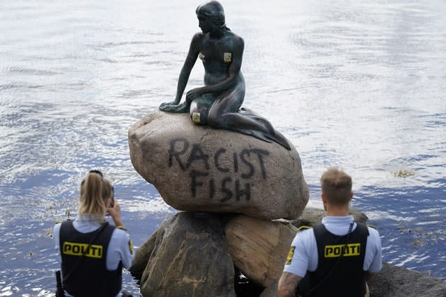 Police stand by the statue (Mads Claus Rasmussen/AP)