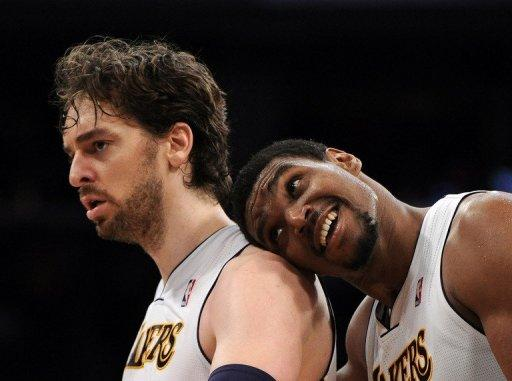 Pau Gasol (L) of the Los Angeles Lakers reacts to his three pointer with Andrew Bynum