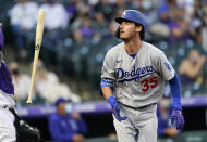 Los Angeles Dodgers' Cody Bellinger tosses his bat after flying out against Colorado Rockies starting pitcher Antonio Senzatela in the second inning of a baseball game Friday, April 2, 2021, in Denver. (AP Photo/David Zalubowski)