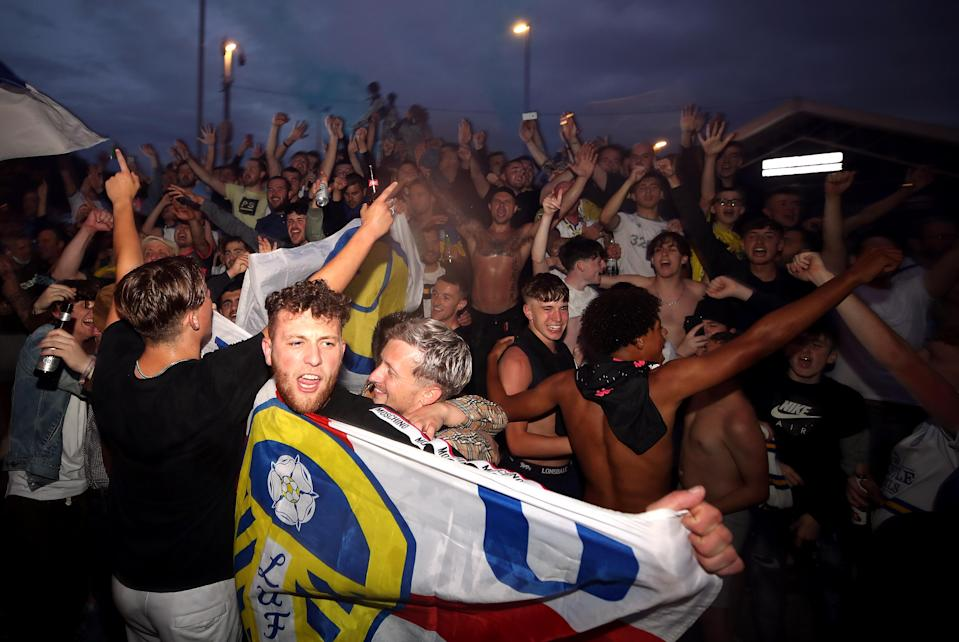 Leeds supporters partied outside Elland Road on Friday night after their club clinched promotion to the Premier League. (Photo by Nick Potts/PA Images via Getty Images)