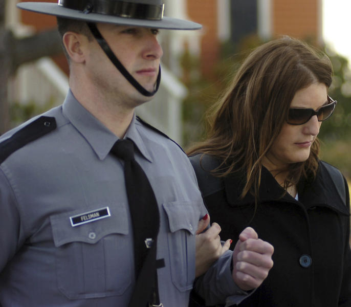 "FILE- In this Jan. 5, 2015, file photo, Tiffany Dickson, of Dunmore, widow of slain Pennsylvania State Police Trooper Cpl. Bryon Dickson, is escorted by a Pennsylvania State Police Trooper during a preliminary hearing for accused killer Eric Frein at the Pike County Courthouse in Milford, Pa. ""I don't have a break. I'm just really tired,"" Tiffany Dickson told jurors Thursday, April 20, 2017, at the trial of her husband's killer. ""He was my break and he was a really good teammate. I'm just angry I can't grow old with him now."" (Butch Comegys/The Times & Tribune via AP, File)"