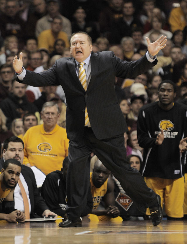 Southern Mississippi coach Donnie Tyndall yells at his team during the second half against Minnesota in an NCAA college basketball game in the third round of the National Invitational Tournament in Minneapolis, Tuesday, March 25, 2014. Minnesota won 81-73.(AP Photo/Tom Olmscheid)