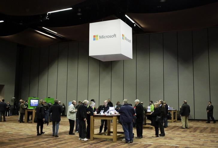 Microsoft Corp shareholders look at Microsoft products before the start of the annual shareholders' meeting in Bellevue, Washington December 3, 2014. REUTERS/Jason Redmond/Files