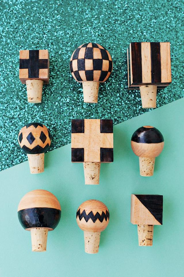 """<p> He'll cap his wines in style thanks to these burned <a href=""""http://abeautifulmess.com/2016/02/diy-wood-burned-bottle-stoppers.html"""" target=""""_blank"""" class=""""ga-track"""" data-ga-category=""""Related"""" data-ga-label=""""http://abeautifulmess.com/2016/02/diy-wood-burned-bottle-stoppers.html"""" data-ga-action=""""In-Line Links"""">wooden bottle stoppers</a>.</p>"""
