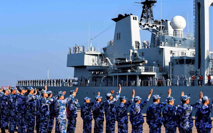 Soldiers of the Chinese People's Liberation Army (PLA) Navy take part in a ceremony - CHINA DAILY