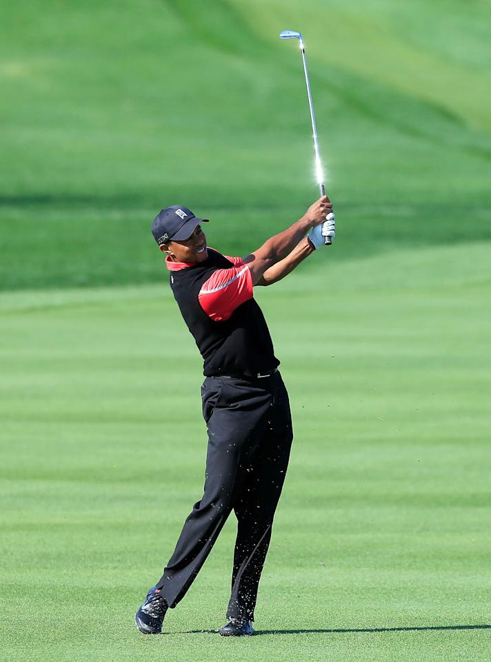 ORLANDO, FL - MARCH 25:  Tiger Woods plays a shot on the 3rd hole during the final round of the Arnold Palmer Invitational presented by MasterCard at the Bay Hill Club and Lodge on March 25, 2013 in Orlando, Florida.  (Photo by Sam Greenwood/Getty Images)