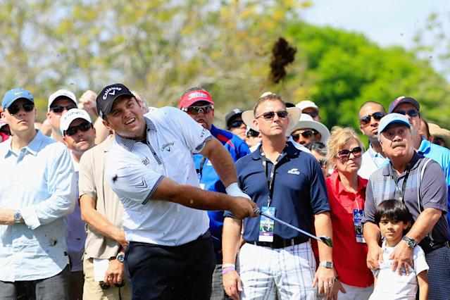 ORLANDO, FL - MARCH 21: Patrick Reed of the United States hits his second shot on the ninth hole in front of a gallery of fans during the second round of the Arnold Palmer Invitational presented by MasterCard at the Bay Hill Club and Lodge on March 21, 2014 in Orlando, Florida. (Photo by Michael Cohen/Getty Images)