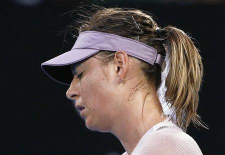 FILE PHOTO - Tennis - Australian Open - Rod Laver Arena, Melbourne, Australia, January 20, 2018. Maria Sharapova of Russia reacts during her match against Angelique Kerber of Germany. REUTERS/Thomas Peter
