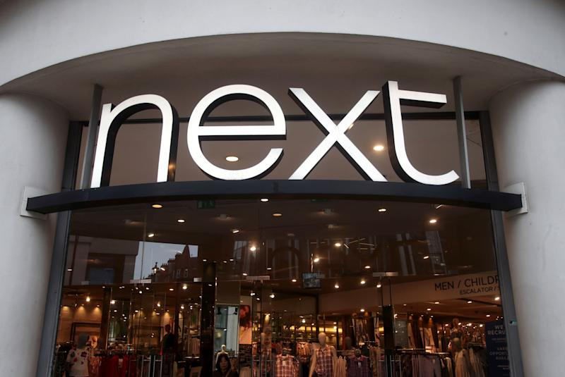 File photo dated 29/05/18 of a branch of Next. The store's sales surged in the past three months as the high street fashion brand was buoyed by warm weather over the Easter period and online sales.