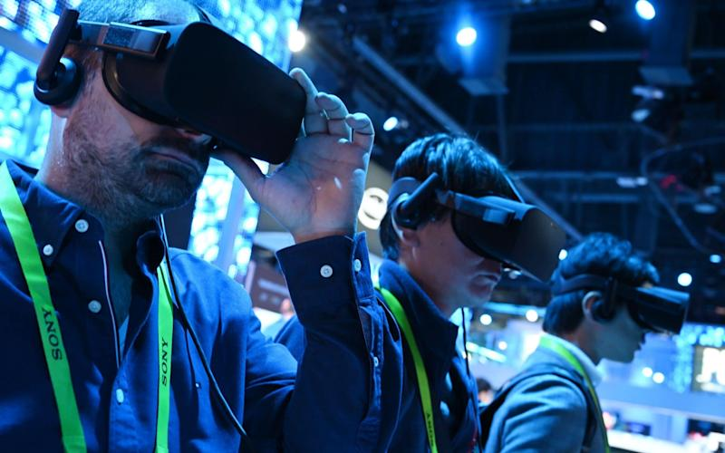 Attendees take a virtual reality tour at an Intel showcase in Las Vegas, January 2019 - AFP