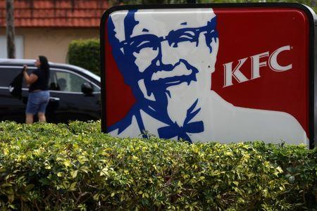 FILE PHOTO: A Kentucky Fried Chicken (KFC) logo is pictured on a sign in North Miami Beach