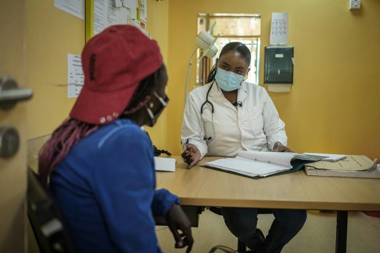 Help: Addiction specialist Angela Thiong'o, right, talks to a 23-year-old heroin user at a clinic run by Doctors Without Borders (MSF) in Karuri