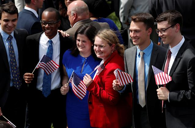 """Guests hold U.S. flags as they attend U.S. President Donald Trump's """"celebration of America"""" event on the South Lawn of the White House in Washington, U.S., June 5, 2018. The event was arranged after Trump canceled the planned visit of the Super Bowl champion Philadelphia Eagles to the White House. REUTERS/Kevin Lamarque"""