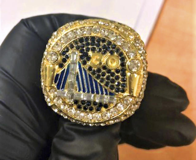 A counterfeit Golden State Warriors championship ring. (AP)
