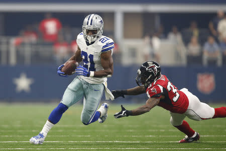 Sep 27, 2015; Arlington, TX, USA; Dallas Cowboys running back Joseph Randle (21) runs the ball against the Atlanta Falcons in the first quarter against the Atlanta Falcons at AT&T Stadium. Mandatory Credit: Tim Heitman-USA TODAY Sports / Reuters Picture Supplied by Action Images