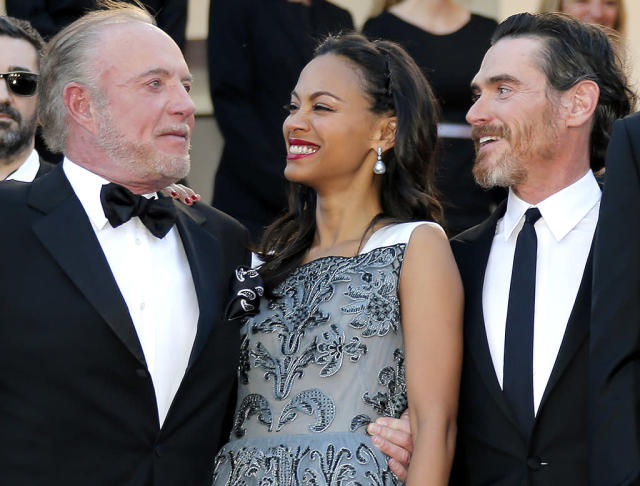 <p><em><em>The star shares a laugh with <em>Blood Ties</em> castmates James Caan and Billy Crudup at the Cannes Film Festival on May 20, 2013. (Photo: Lionel Cironneau/AP) </em></em></p>