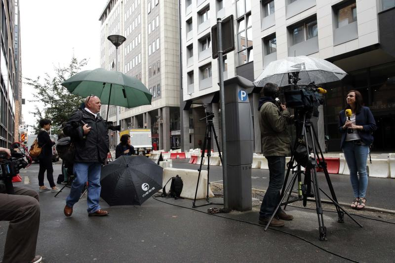 Journalists stand in front of the offices of the judicial police in Nanterre where former French President Nicolas Sarkozy arrived early Tuesday to be quizzed by investigators