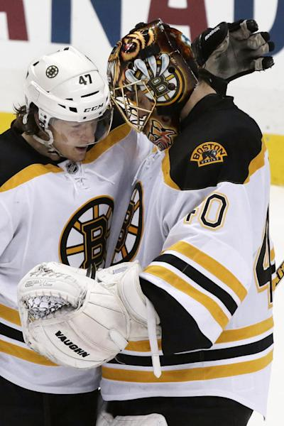 Boston Bruins goalie Tuukka Rask (40) celebrates with Torey Krug after a 6-1 Bruins win over the Pittsburgh Penguins in Game 2 of the NHL hockey Stanley Cup playoffs Eastern Conference finals, in Pittsburgh, Monday, June 3, 2013. (AP Photo/Gene J. Puskar)