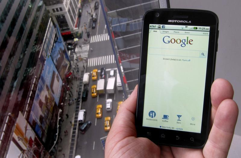 A posed picture shows a Motorola Droid phone displaying the Google search page in New York