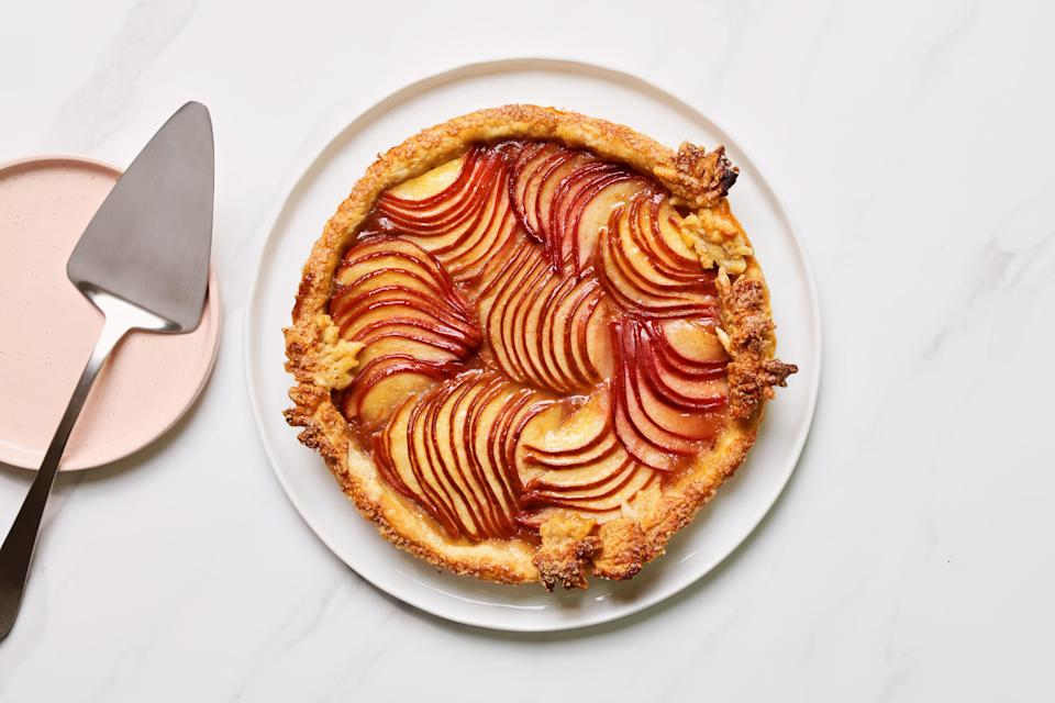 """Wrap up your Thanksgiving meal with this gorgeous tart from Epi contributor Judy Kim. An optional make-ahead dulce de leche drizzle lends an even more impressive look to each slice, but a <a href=""""https://cna.st/affiliate-link/56DCwaYCe2AtnYAy2Ky5RJJhqjJGzHPMPM6S7vkwkQuGpjhjtmY8gEnGFTdaXwM8Any1BZ2G4B8vgSiNrKyvoViZZLxhvY9a4RZHGqXPy56JVj3bLFMtipdWHDipKjngoc?cid=5d9f52507e9a8e0008826faf"""" rel=""""nofollow noopener"""" target=""""_blank"""" data-ylk=""""slk:store-bought version"""" class=""""link rapid-noclick-resp"""">store-bought version</a> works well, too. <a href=""""https://www.epicurious.com/recipes/food/views/pear-tart-dulce-de-leche-drizzle-judy-kim?mbid=synd_yahoo_rss"""" rel=""""nofollow noopener"""" target=""""_blank"""" data-ylk=""""slk:See recipe."""" class=""""link rapid-noclick-resp"""">See recipe.</a>"""