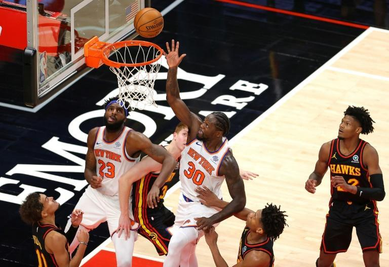 New York's Julius Randle tips in a basket in the Knicks' 113-108 NBA victory over the Atlanta Hawks