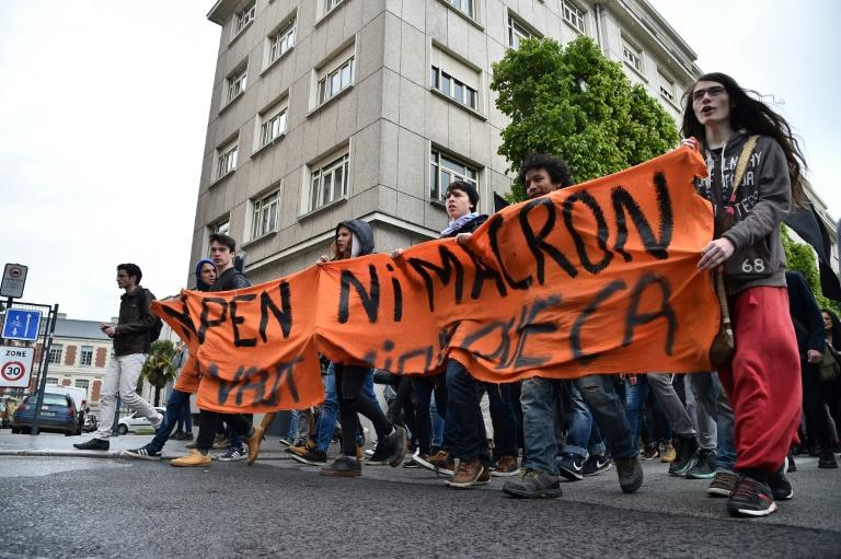 "Protesters hold a banner reading ""Neither Le Pen nor Macron"" at a demonstration in the French city of Rennes"
