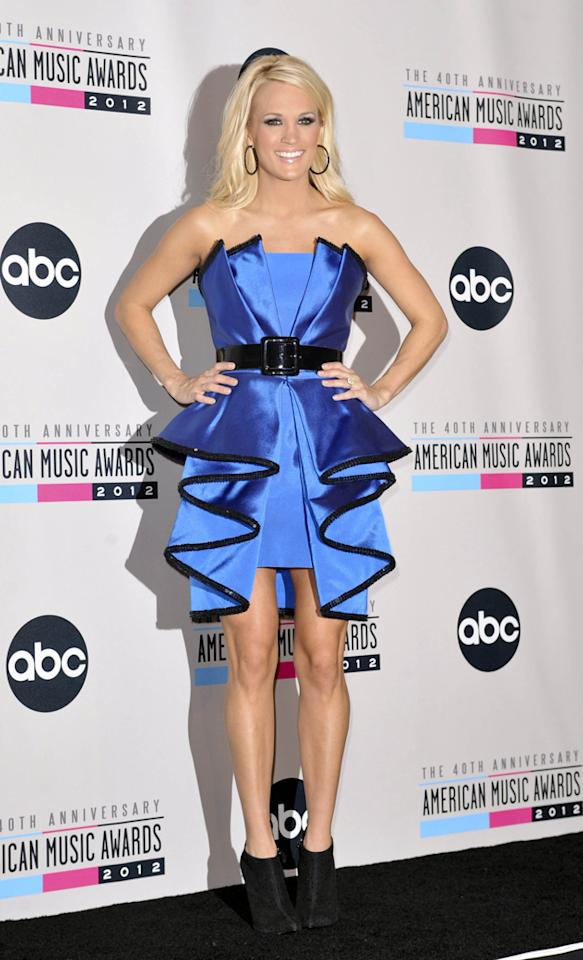 AMAs 2012: Carrie Underwood's second outfit was a bit of a fashion fail. This blue ruffled dress looks somewhere between a dodgy Lady Gaga cast-off and a Quality Street wrapper. We like the shoe boots, though. Copyright [WENN]