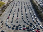 Cars line up in a parking lot at NRG Park as people wait to receive a COVID-19 vaccine at a federally supported supersite at the Harris County facility, Wednesday, Feb. 24, 2021, in Houston. ( Mark Mulligan/Houston Chronicle via AP)