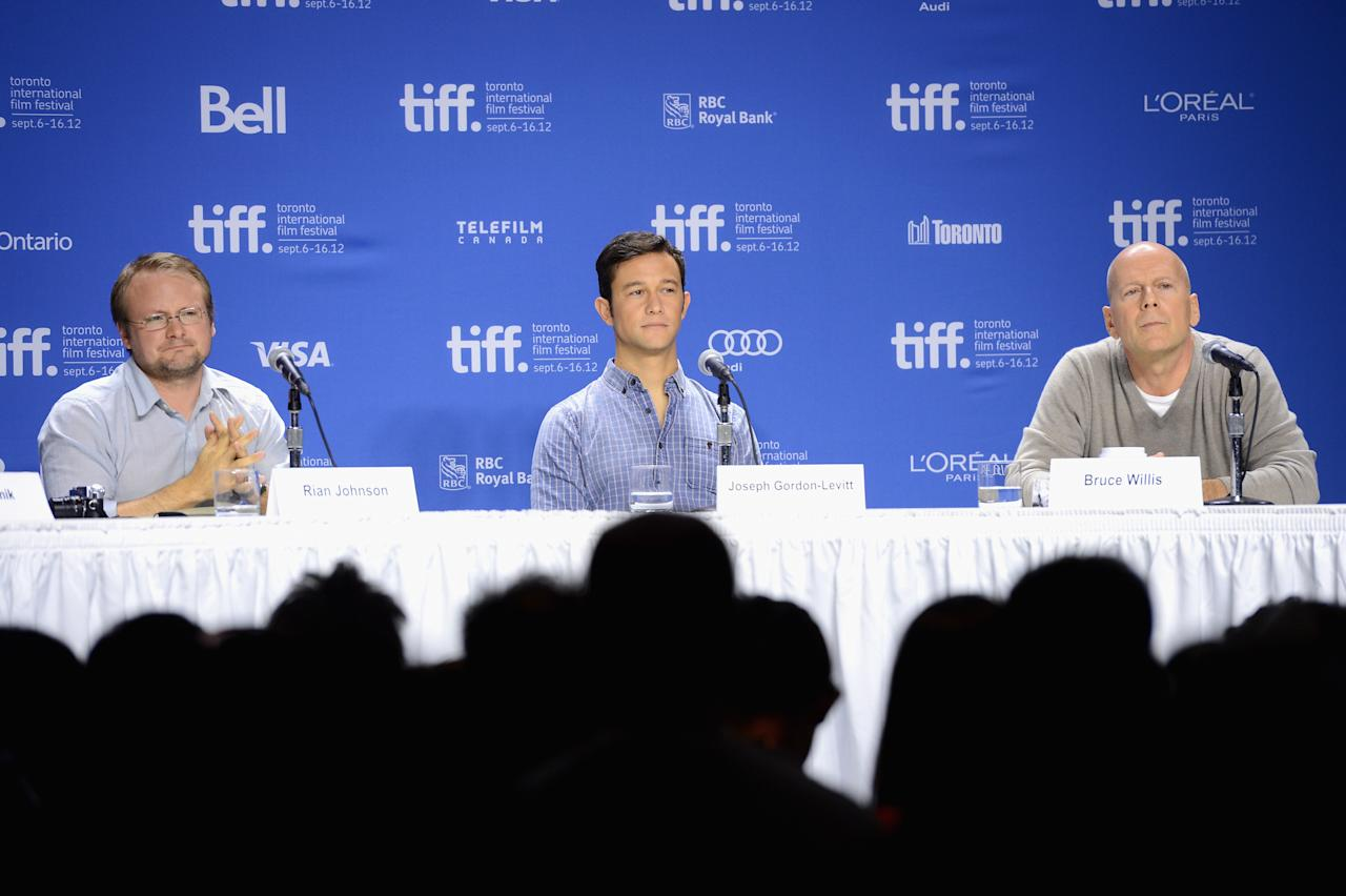 "TORONTO, ON - SEPTEMBER 06:  (L-R) Actors Joseph Gordon-Levitt, Bruce Willis and Director Rian Johnson speak onstage at the ""Looper"" press conference during the 2012 Toronto International Film Festival at TIFF Bell Lightbox on September 6, 2012 in Toronto, Canada.  (Photo by Jason Merritt/Getty Images)"