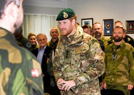 Britain's Prince Harry, Duke of Sussex talks to British and Norwegian military personnel in Bardufoss, Norway February 14, 2019. NTB Scanpix/ Rune Stoltz Bertinussen via REUTERS