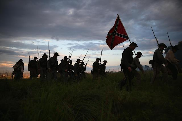 GETTYSBURG, PA - JUNE 29: Confederate Civil War re-enactors march for an evening attack during a three-day Battle of Gettysburg re-enactment on June 29, 2013 in Gettysburg, Pennsylvania. Some 8,000 re-enactors from the Blue Gray Alliance are participating in events marking the 150th anniversary of the July 1-3, 1863 Battle of Gettysburg, considered the turning point in the American Civil War. Union and Confederate armies suffered a combined total of some 46,000-51,000 casualties in the battle, the highest of any conflict of the war. (Photo by John Moore/Getty Images)