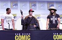 <p>The future Cyborg, the Flash, and Aquaman, Ray Fisher, Ezra Miller (in Gandlaf cosplay), and Jason Momoa, at the Warner Bros. panel on July 23.<i> (Photo: Albert L. Ortega/Getty Images)</i></p>