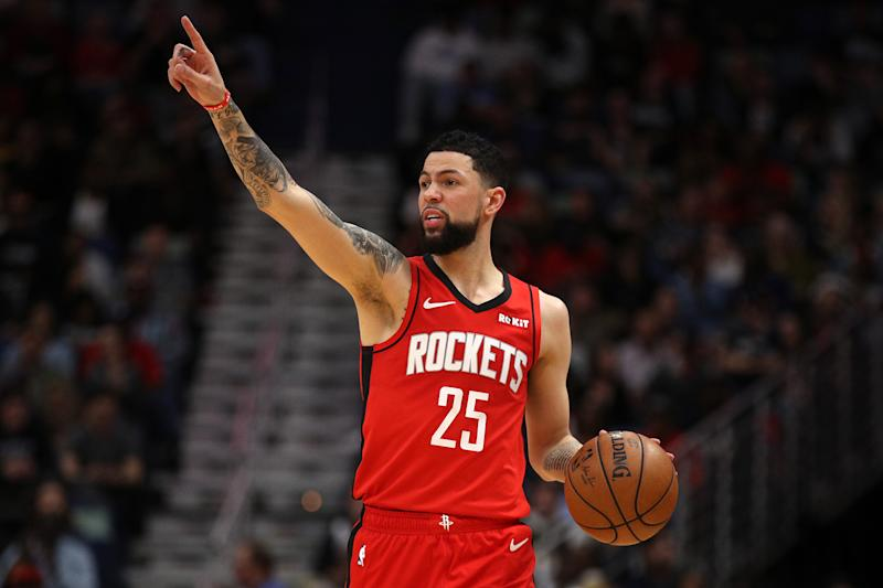 After stealing a rebound from James Harden on Tuesday night, Austin Rivers instantly felt terrible. (Chris Graythen/Getty Images)
