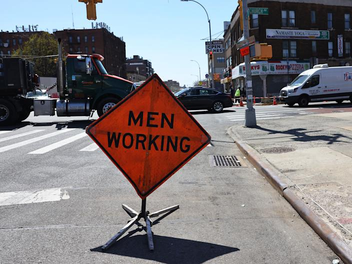 <p>A 'Men Working' sign is seen on the site of infrastructure repairs on the intersection of Church Avenue and Coney Island Avenue in the Flatbush neighborhood of Brooklyn borough on 6 April, 2021</p> (Getty Images)